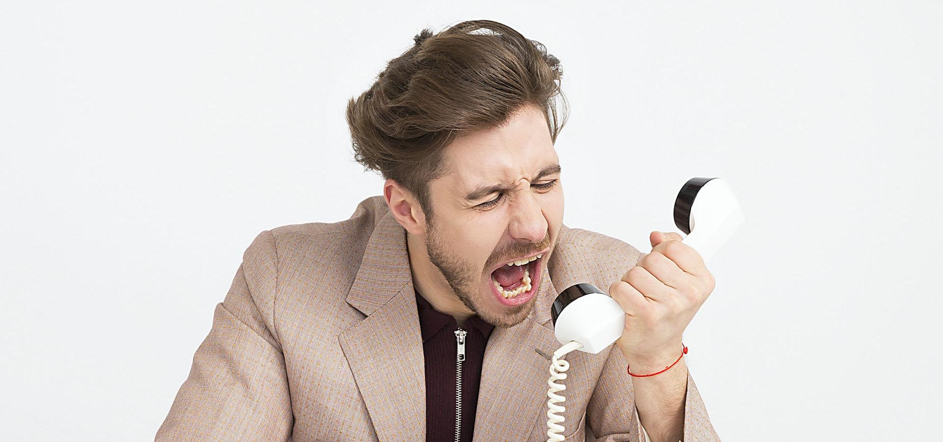 Man Screaming down telephone